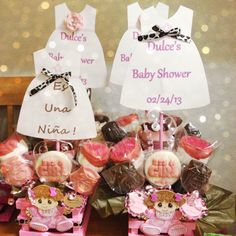 Centerpieces girl baby shower: thinking pattern paper dresses with solid color bows. Too cute!!