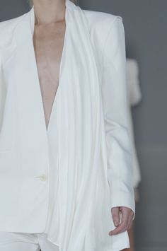 White collarless blazer with an asymmetric draped panel; chic fashion details // Hussein Chalayan
