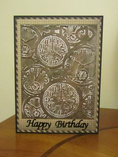 Masculine Card using Texture Fades Clocks embossing folder by Tim Holtz Alterations/Sizzix. Colored with Faber Castell Gelatos Steampunk set. Sentiment by Elizabeth Craft peel-offs.