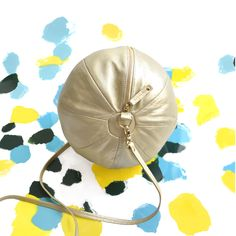 BEA BÜHLER / BALLOON BAG / BALLOON COLLECTION / Made in France. Key feature: elegantly roomy, worn on or across the shoulder with leather strap / Dimensions: circumference 68 cm diameter 21 cm / Material: softest lamb leather, lining cotton, chain gold plated (optional)