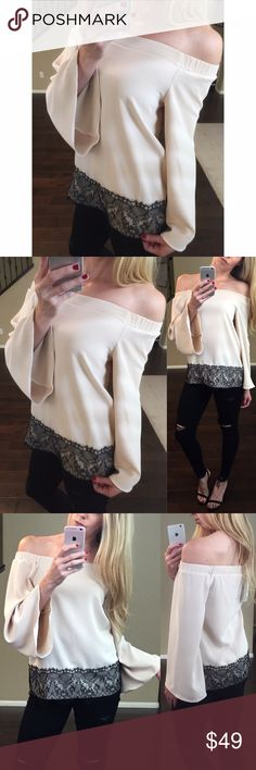"""🏳Lace Bottom Off the Shoulder Top Bare your shoulders in this sexy top, with black lace trim and bell sleeves! Solid woven fabric with a soft buttery feel. Straight hem and elastic shoulders. Available in nude and blush (see other listing)   •Color: Nude  •Fit: TTS, relaxed A-line shape  •Material: 97% poly 3% spandex  •Measurements: (M) across the top 18"""" stretches 4"""" more. Pit to pit 18.5"""" Length 22"""" •Price is firm unless bundled  Style like tags Free People Guess Zara ShopInBed Tops…"""