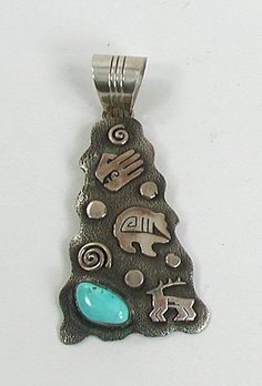 Native American Sterling Silver turquoise symbols pendant by Navajo Scott Skeets