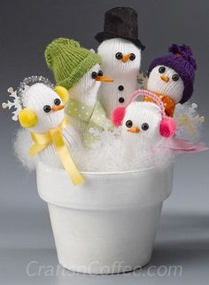 Cute, handful of snowmen made with a white glove and terra cotta flower pot