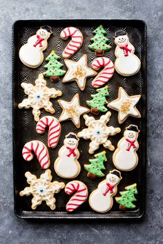 Create beautiful decorated Christmas sugar cookies with this awesome sugar cookie and royal icing recipe! sallysbakingaddiction.com