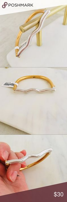 """MADEWELL Modernism Bar Bracelet PRODUCT DETAILS A play on line and form, this mixed-metal bracelet has a hidden latch closure for a streamlined look—just push the button to open (genius). * Diameter: 1 3/4"""" x 2 1/4"""". * Brass. * Clean your jewelry after each wearing with a soft cloth. Madewell Jewelry Bracelets"""