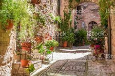 Wonderful decorated porch in small town in Italy in summer royalty-free stock photo