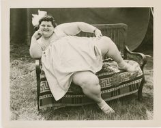 Baby Thelma Williams as the circus Fat Lady seen here reclining. Early photo possibly taken at the Champlain Valley Fair.