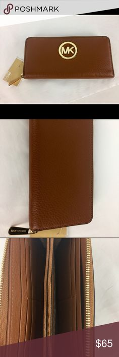 """Michael Kors Fulton Zip Around Continental Wallet Condition: New with Tag. M1   Continental wallet made of leather Zip-around closure Signature logo hardware Features a center zip pocket, a currency compartment, and card slots Lined interior. 4""""H x 8"""" W     Thank you for your interest! No Trades please. Michael Kors Bags Wallets"""