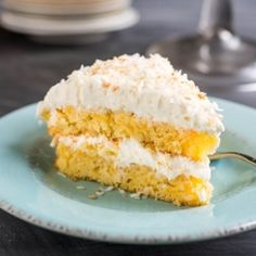 This Pineapple Coconut Cake is loaded with fresh pineapple and covered in a super fluffy whipped coconut frosting. It'll take you right to the tropics!