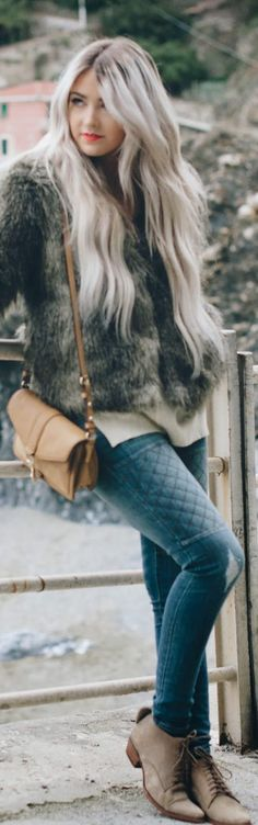 This entire look, from the her hair matching the fur vest, to the light booties, is well put together. I really like the quilt detail on the jeggings!