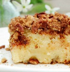 Cream Cheese Apple Cake...This apple cake is made moist and tender by adding cream cheese to the cake batter. It's filled with chopped apples and the wonderful flavors of brown sugar, cinnamon and pecans. You're going to love it!