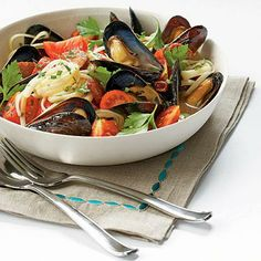 Mussels with Smoked Sausage and Tomatoes | Using fresh pasta makes this dish easy to prepare.