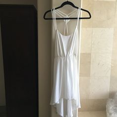 White high low dress worn once. Slip needs to be worn under.  Very pretty with the diamond shape in the back and 3 straps. Dresses High Low
