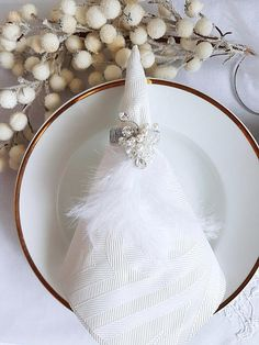 Check out this item in my Etsy shop https://www.etsy.com/listing/574165473/crystal-pearl-napkin-rings-feather