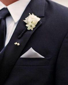 simple, elegant ~ love a man's boutonniere to be wrapped in black ribbon on a black tuxedo