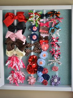 Great hairbow holder.  All tucked inside of a neat little cabinet with.  The front has a pretty initial on it that's done with glitter spray paint!