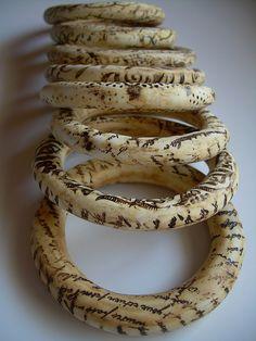 Elvira López Del Prado Rivas, faux ivory/bone bangles made from polymer clay.