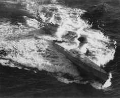 Type IXC/40 U-Boat U-185 foundering in the mid-Atlantic after an aerial depth charge attack by a TBF-1 Avenger from Escort Carrier USS Core 24 August 1943. 36 crew members were rescued while 43 perished.