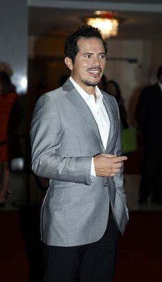 We see you too, John! Actor/comedian John Leguizamo enjoys the crowd on the red carpet. (Credit: Scott Suchman)