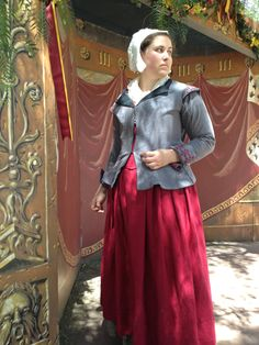 Tudor kirtle & coat & cap. You can see the embroidery a little bit better here.