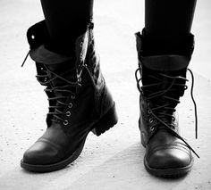 Big black boots, long brown hair..