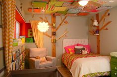 Fun big girl room with mixed patterns and whimsical touches on the ceiling -