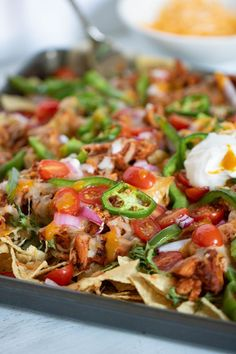 These Sheet Pan Buffalo Chicken Nachos are guaranteed to be a show-stopper! This recipe comes loaded with deliciously spicy buffalo shredded chicken + more. Buffalo Chicken Dip Ingredients, Healthy Buffalo Chicken Dip, Buffalo Chicken Pasta Salad, Chicken Stuffed Shells, Buffalo Chicken Nachos, Shredded Buffalo Chicken, Buffalo Chicken Meatballs, Chicken Dips, Chicken Nachos Recipe
