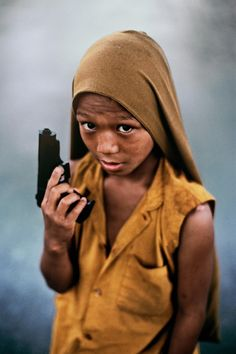 poor child, where would their parent be? isn't it to soon to hold a gun? why don't you just go school and be like any other children