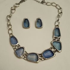 Vintage Avon Blue Necklace and Earrings Silver with large clear blue gems. One earring shows a little wear. Vintage Jewelry Necklaces