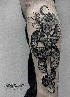 Snake tattoo on calves black and grey by Stanislav Sidorov