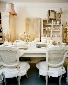 white cane chairs | Cane Back Chair - White cane-back chairs surrounding a white dining ...