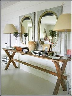 X shaped saw type hall table is good for narrow hallways  @Alysha Schmidt Slone I bet Clint could make this. It could be a big seller :)