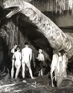 One night at the museum ... Vintage photo of nude and aspiring archaeologists at the dinosaur exhibit.