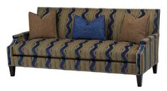 MASSOUD This exclusive sofa features Magic Blue fabric with contrasting fabrics and trims and streamlined wooden legs.