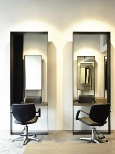 mirrors with foot rest if mounted off the ground & has a small shelf for coffee. Travis Walton Architecture / hair salon