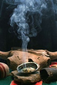 Smudging—the act of burning herbs to purify negative energy—is a common practice in feng shui, as well as in Native American and Eastern traditions. Evil Spirits, Book Of Shadows, Feng Shui, Nativity, Buddha, Sage Smudging, Smudging Prayer, Smudge Sticks, Wiccan