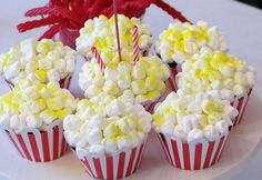 Carnival Popcorn Cupcakes - Designed by Cakes By Jen and snapped by Jennifer Larkin from The Paper Peony, serve these cute popcorn cupcakes in red and white striped cupcake sleeves or liners. Juneberry Lane shares the full tutorial and free cupcake wrapper printable. Get the DIY here.