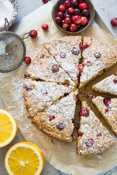 cranberry orange cake on a baking sheet with slices, sprinkled with powdered sugar with fresh cranberries and oranges surrounding cake Make Ahead Breakfast, Breakfast Cake, Breakfast Ideas, Paleo Cake Recipes, Free Recipes, Paleo Baking, Baking Flour, Cranberry Orange Cake, Traditional Cakes
