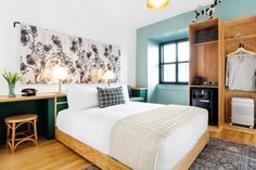 Upstairs, the rooms were designed to with homey finishes that are meant to remind guests of a residential setting. Portland Hotels, Public Hotel, Century Hotel, Private Dining Room, Hotel Interiors, Guest Bedrooms, Guest Room, Beautiful Bedrooms, Contemporary Furniture