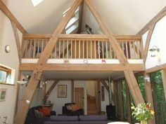 Very simple 2 bed oak frame barn house with sitting room open to 2 sleeping platforms at either end, by Roderick James Architects Barn Conversion Bedroom, Barn Conversion Interiors, Mezzanine Bedroom, Loft Room, Devon House, Oak Framed Extensions, Oak Framed Buildings, Oak Frame House, Barn Kitchen