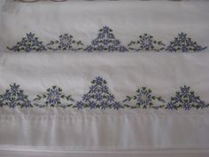Periwinkle flowers embroidered pillowcases