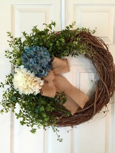 HYDRANGEA WREATH, approx. 19x23 Grapevine Wreath with 2 Large Hydrangeas, Artificial Greenery, and Burlap Bow. Customize your own Wreath, please leave flower color and ribbon choice in notes to seller. Last picture shows Grey/Cream chevron ribbon available. Flower colors- White, Cream, Turquoise, Dark Pink, Tan, Moss Green, Dark Orange, Purple, Light Purple, Light Pink, Brown... Please send a convo if you have any questions. Thank you for looking