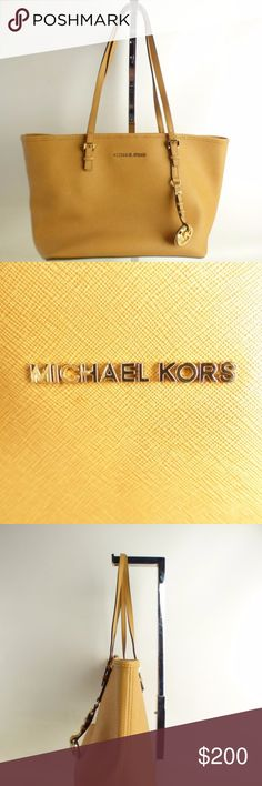 Michael Kors Jet Logo Tote Leather Tan Brand: Michael Kors  Color: Tan  Length (in.): 11.5  Width (in.): 5.5  Height (in.): 8.5  Strap Drop (in.): 8.5  Total Pockets: 2 Interior (1 Has a Zipper) Michael Kors Bags Totes