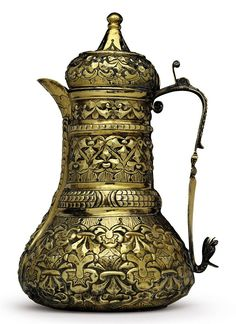 A SILVER-GILT EWER OTTOMAN TURKEY, LATE 18TH/EARLY 19TH CENTURY Of squat bulbous form, the tall tubular neck rising from a rounded ring to a bulbous lid with tapering finial hinged to the straight handle, the everted spout raised above the surface, the repoussé decoration of stylized foliage over punched ground, the base of the spout decorated with a grotesque mask, the handle with human mask and issuing a dragon's head, marked '443' 19.6cm.