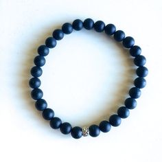 Genuine Matte Black Onyx Bracelet  w/ Sterling Silver Charm ~ 6mm Beads on Etsy, $24.00