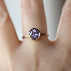 PurpleBlue Tanzanite Ring in 14K Rose Gold  Ready by louisagallery. Or this one!