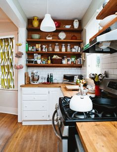 I'm scared of open cabinets (earthquakes; and my messiness); but I love the white tile and wood countertops.