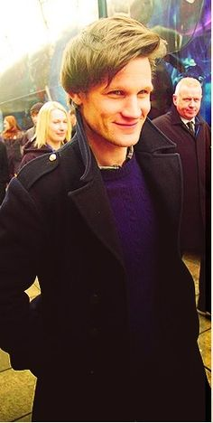 Matt Smith... But what is it with British people and black trench coats with the collar turned up (a la Sherlock)?