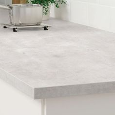 "EKBACKEN Countertop, light gray concrete effect, laminate, 74x1 1/8"". Spills and grease are easy to wipe clean and the countertop retains its beauty over time. Choose between the many colors and expressions to find the perfect look. Countertop Concrete, Kitchen Countertop Materials, Laminate Countertops, Ikea Kitchen Countertops, Cheap Countertops, Kitchen Cabinets, Quartz Countertops, White Cabinets, Sandstone Countertops"