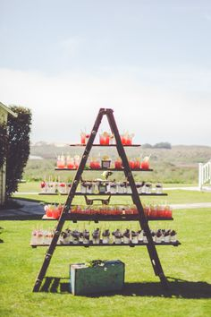 Yes, this cool ladder-turned-drink stand is technically for a wedding, but theres no reason you cant try this trick at your next backyard bash. Throw wooden planks between the rungs to create a stable surface and start loading em up. See more at 100 Layer Party Hacks, Party Ideas, Drink Stand, Old Ladder, Vintage Ladder, Barn Parties, Bar Drinks, Drink Bar, Beverages
